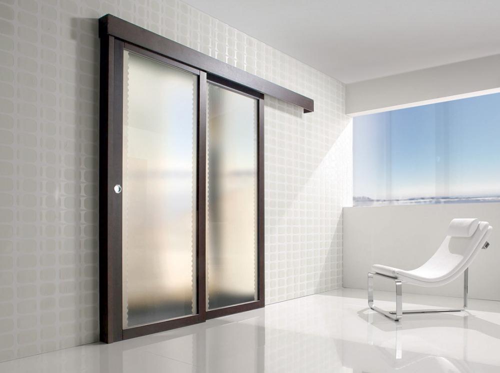 Porte interne in legno ellegi serramenti installazione - Porte scorrevoli per interni ...
